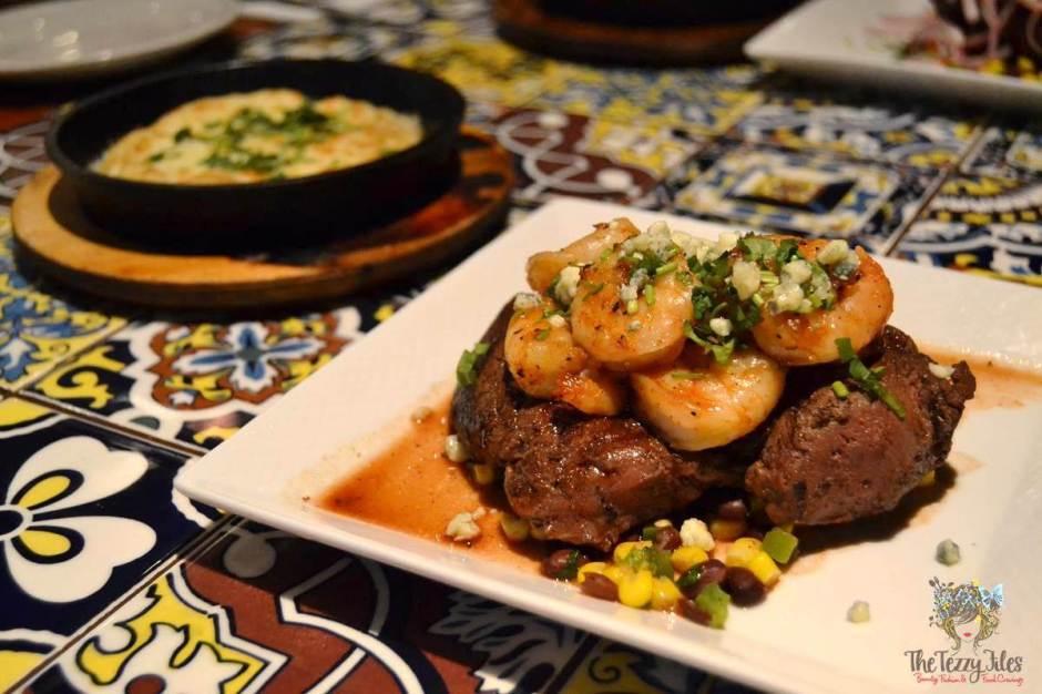 chili's chef cuts glazed shrimp fillet