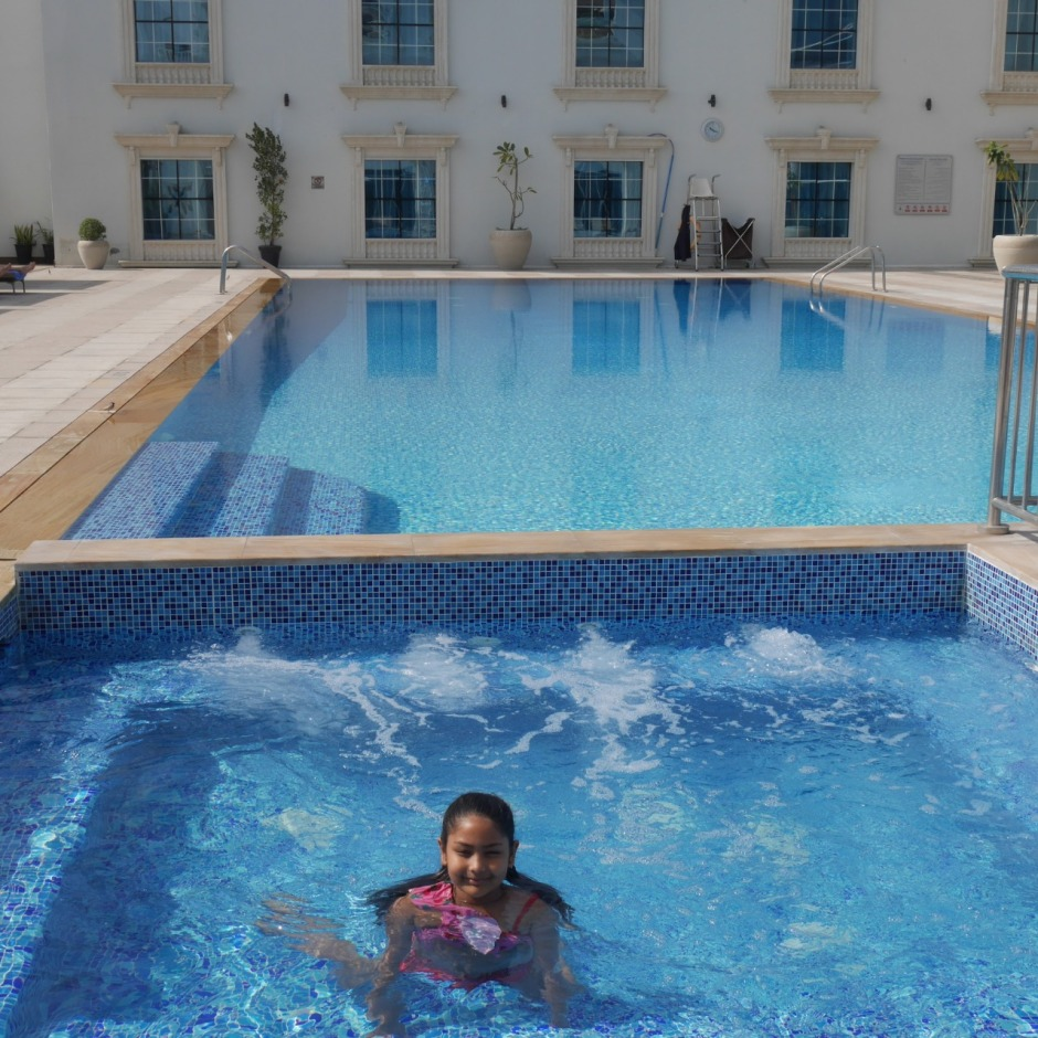 Staycation at radisson blu ajman the tezzy files for Public swimming pools in ajman